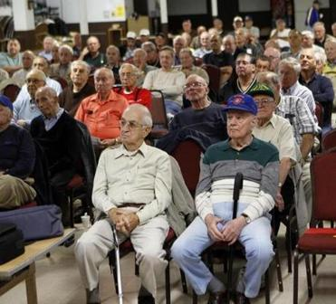 The Retired Men's Club of Arlington hosts an early morning meeting at St. Camillus Church. The meetings often feature guest speakers.